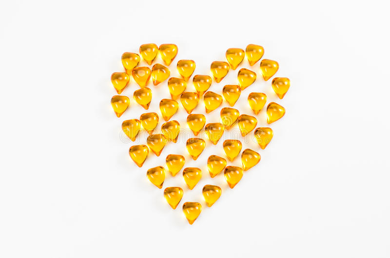 Fish oil with heart shape stock image
