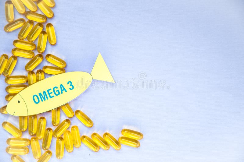Fish oil omega 3 soft gel capsule pills, healthy product   and   supplement  concept close up, space for text, stock photo