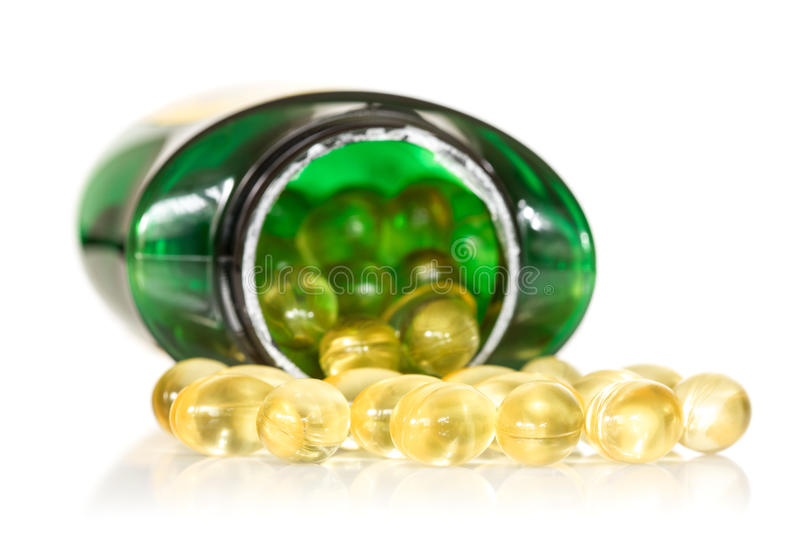 Fish oil scattering on white background stock images