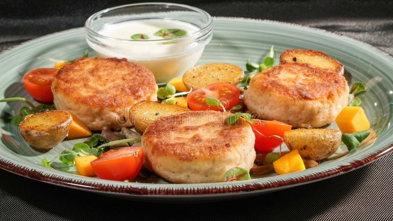 Fish patties with a side dish royalty free stock images