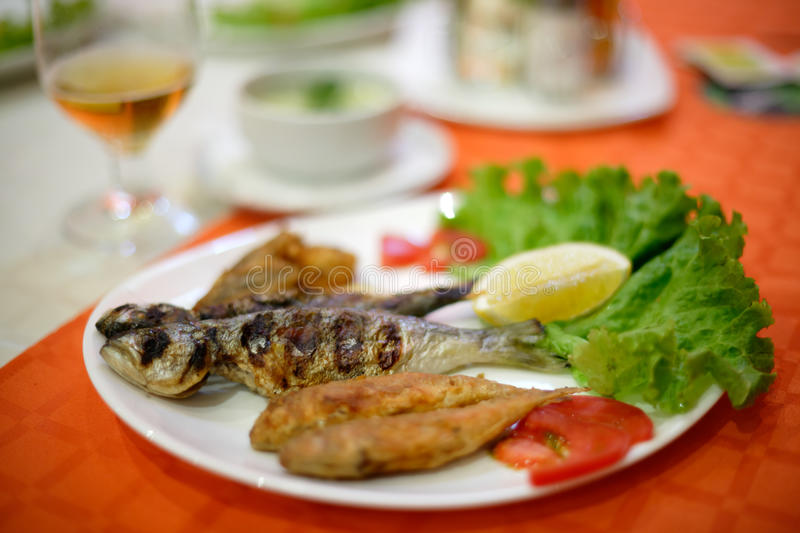 Fish plate. Plate with grilled fish from the Black sea, Bulgaria stock image