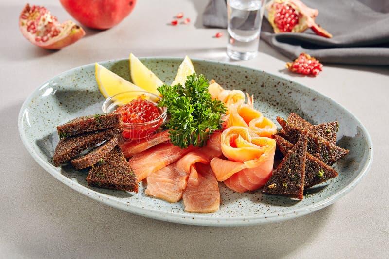 Fish platter with light-salted salmon, smoked salmon, red caviar royalty free stock photo