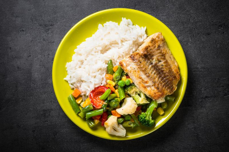 Fish, rise and vegetables. stock images