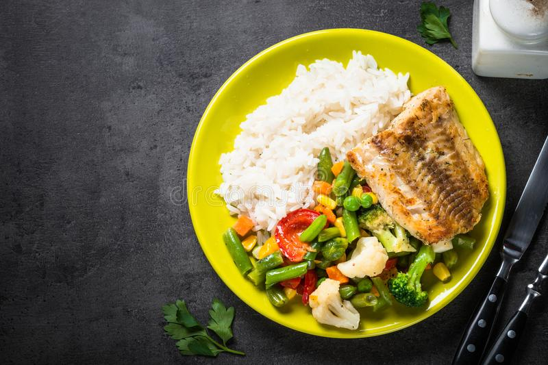 Sea fish, rise and vegetables. stock image