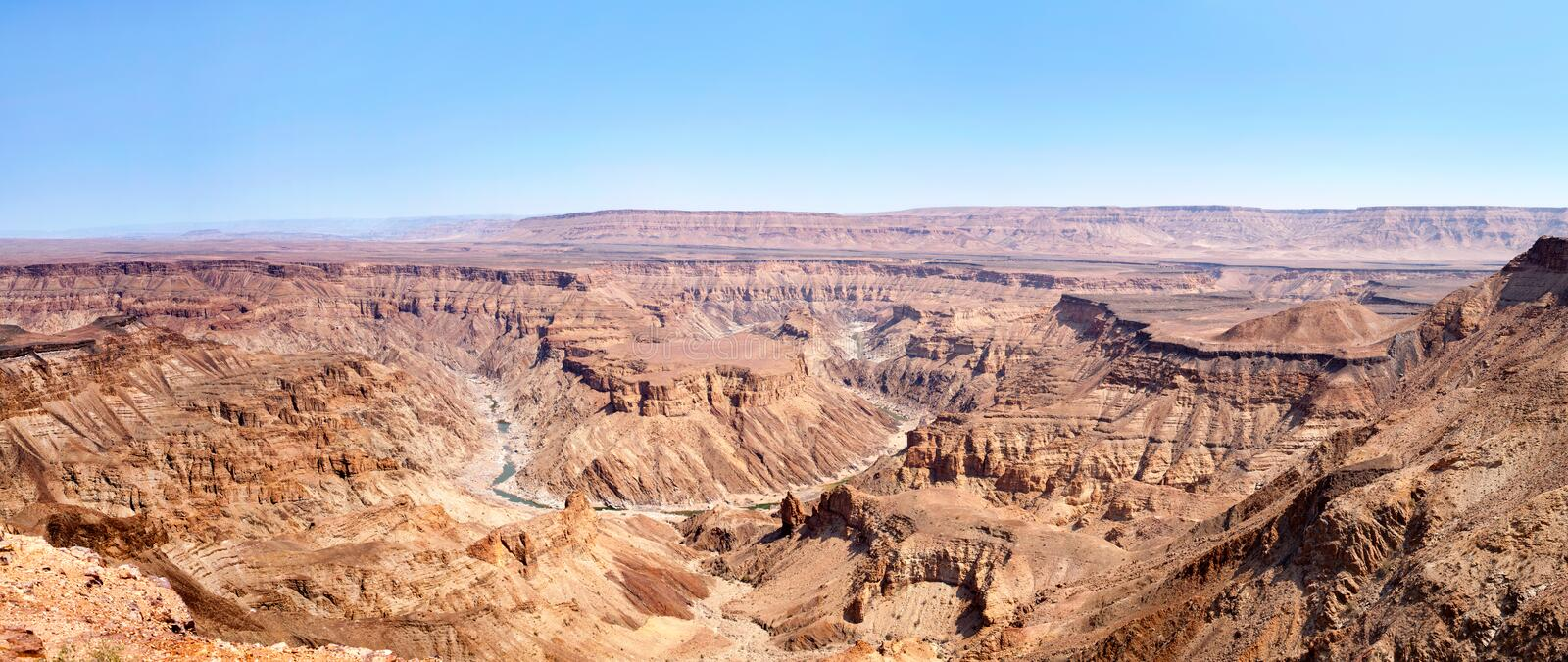 Fish River Canyon during the dry season top view, beautiful scenic mountain landscape panorama in Southern Africa, Namibia royalty free stock images