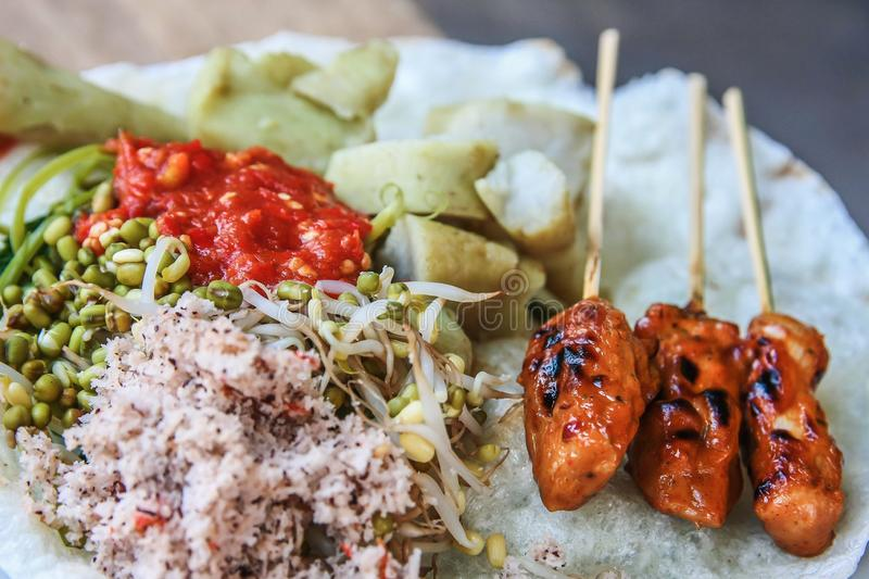 Sate Ikan Tanjung Fish Satay. Indonesian traditional food from Lombok called Sate Ikan Tanjung served With crackers, vegetables & rice cake royalty free stock images