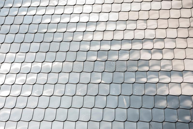 Fish scale texture silver metal shape wall cover chrome reflection background. Fish scale texture silver metal shape wall cover with chrome reflection background royalty free stock photo