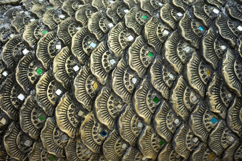 Fish scales pattern or ancient dragon scales By public day in Thailand Popularly decorated according to Buddhist places royalty free stock photo