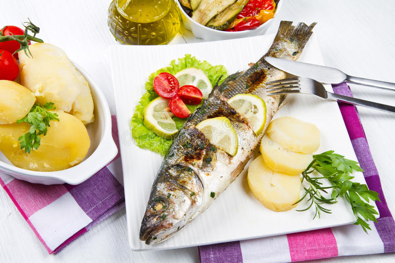 Fish, sea bass grilled royalty free stock photo