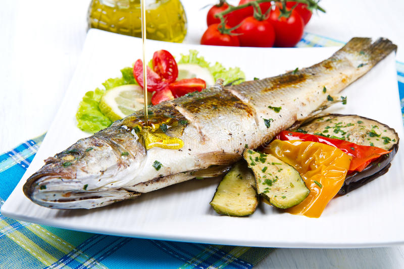 Fish, sea bass grilled royalty free stock photos
