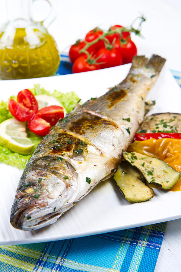 Fish, sea bass grilled with lemon stock image