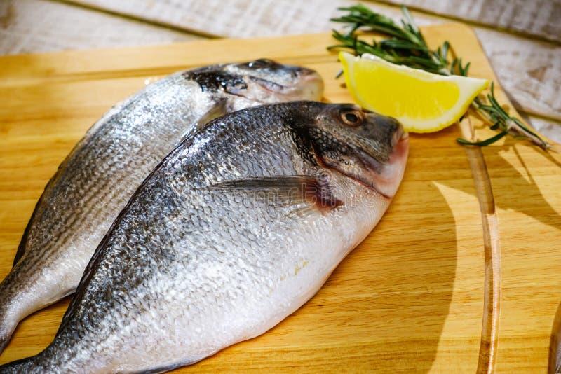 Fish seafood dorado, raw food, uncooked. Fish seafood dorado, raw food on cutting board, uncooked royalty free stock photos
