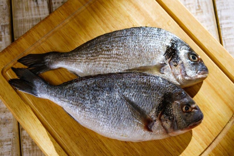 Fish seafood dorado, raw food, meal. Fish seafood dorado, raw food on cutting board, meal royalty free stock image