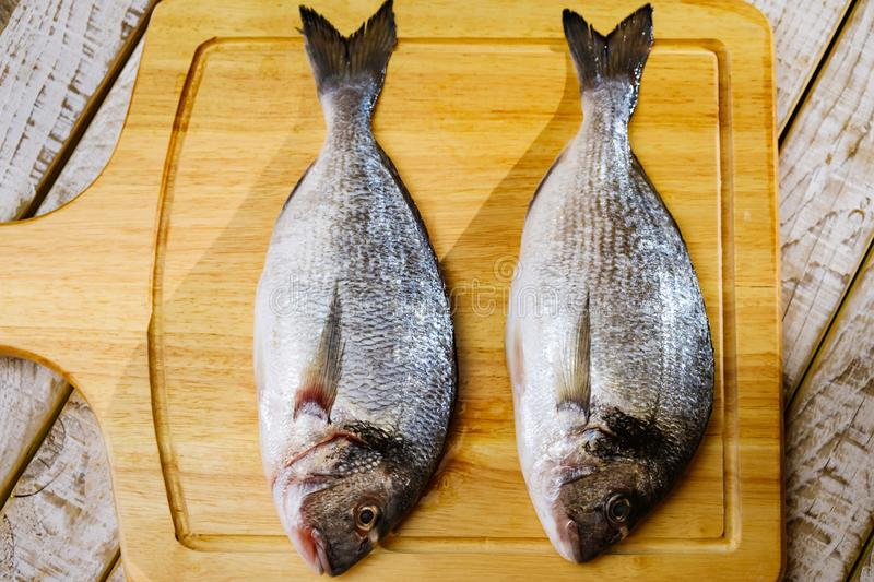 Fish seafood dorado, raw food, meal nutrition. Fish seafood dorado, raw food on cutting board, meal nutrition royalty free stock images