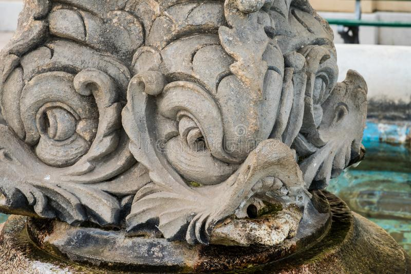 The fish-shaped fountain of church square in Castroreale, Sicily. The name Castroreale comes from Latin, and means `royal fortress royalty free stock image