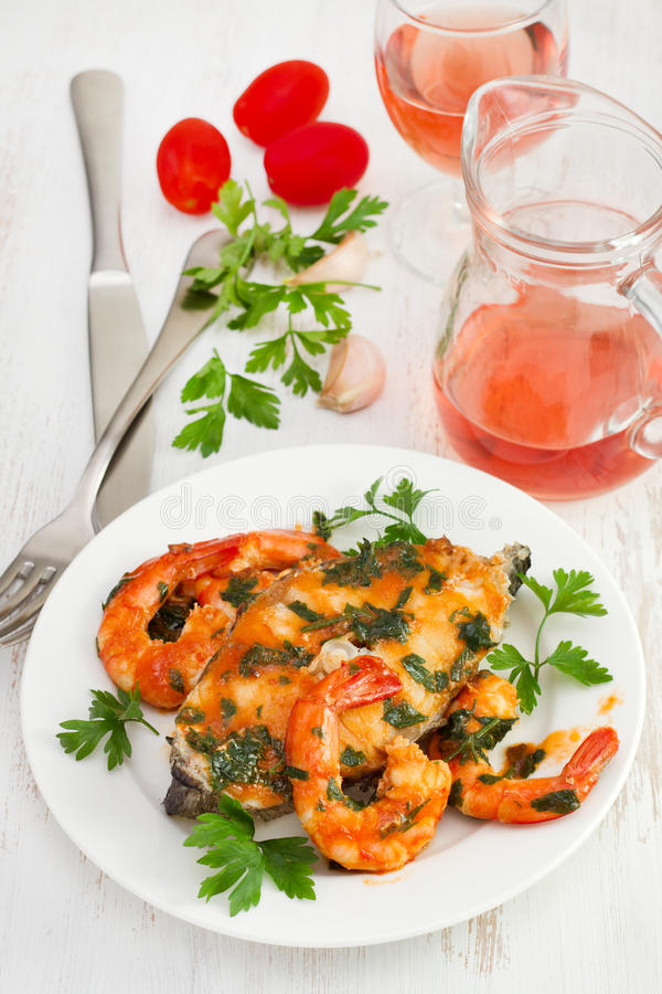 Fish with shrimps in tomato sauce