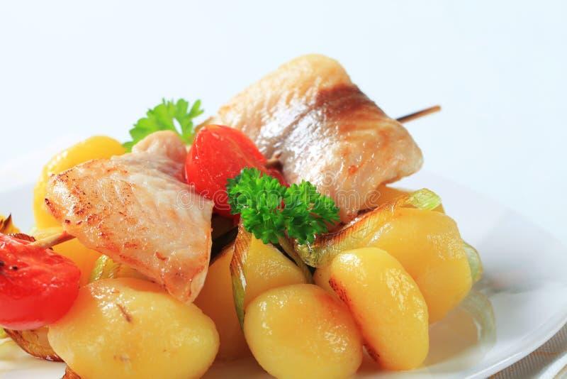 Download Fish skewer and potatoes stock image. Image of food, potatoes - 23710359