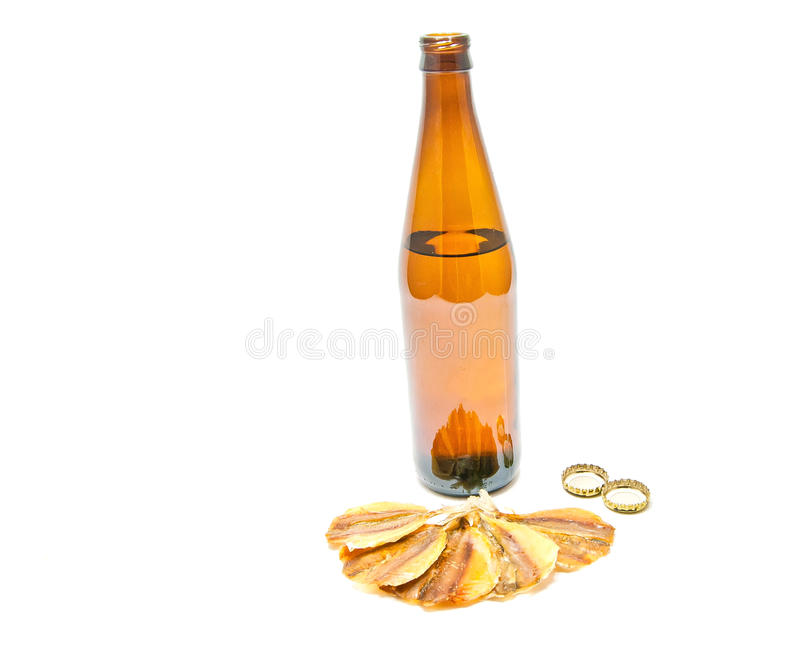 Fish snack and bottle of beer stock photos