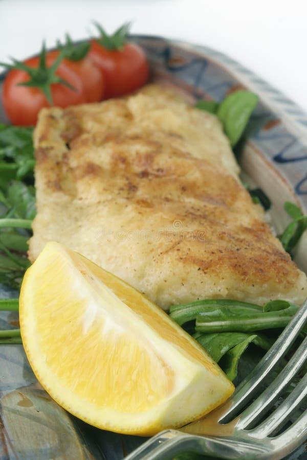 Fish snack on ceramic platter; macro stock photo