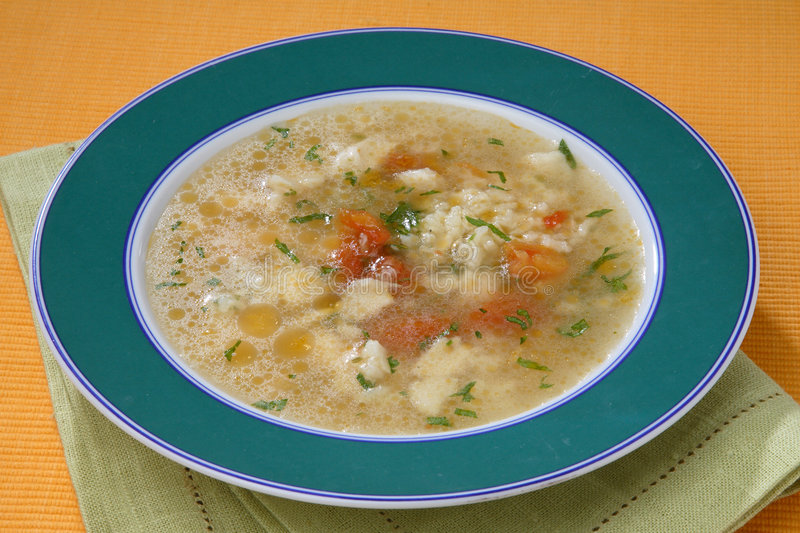 Fish soup with herbs stock images
