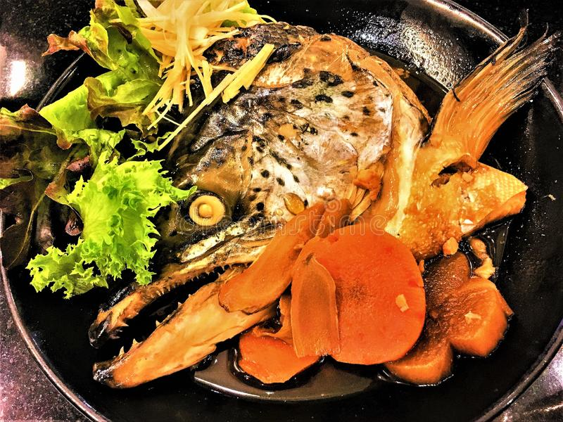 Fish soup Japanese traditional cuisine from the heads of Salmon with carrots. royalty free stock image