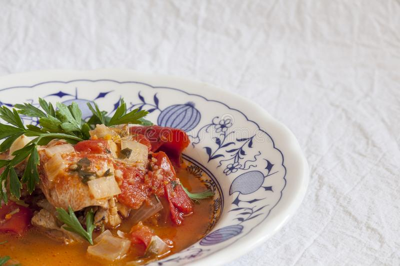 Fish soup, Scorpaena scrofa, with vegetables. Healthy food stock images