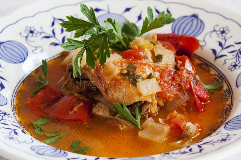 Fish soup, Scorpaena scrofa, with vegetables. Healthy food stock photo