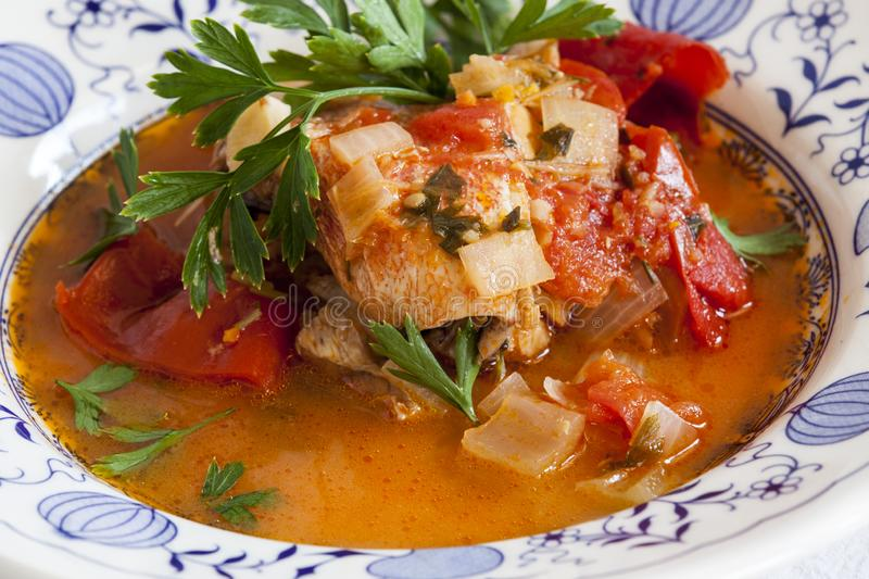 Fish soup, Scorpaena scrofa, with vegetables. Healthy food royalty free stock photos