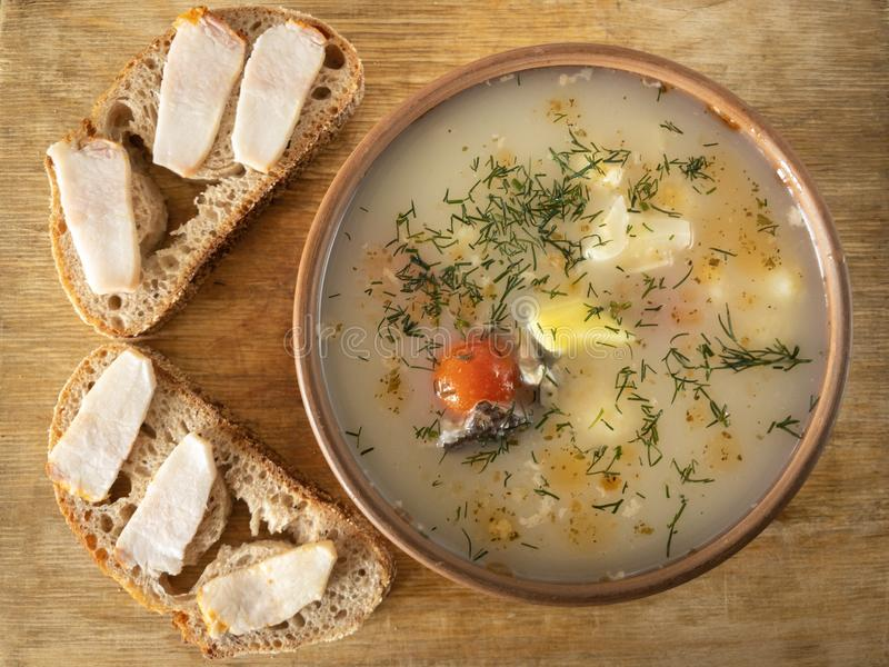 Fish soup and two sandwiches with slices of pork royalty free stock image