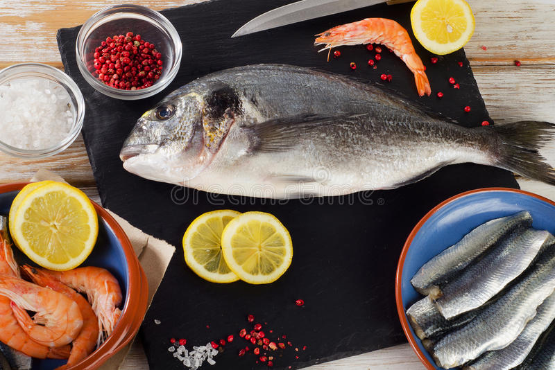 Fish with spices , salt and shrimps - healthy food. royalty free stock photography