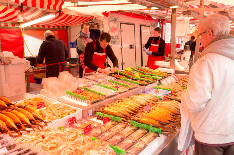 Fish stall at the Albert Cuyp market in Amsterdam. NETHERLANDS - AMSTERDAM - CIRCA MARCH 2014: Fish stall at the Albert Cuyp market in Amsterdam royalty free stock images