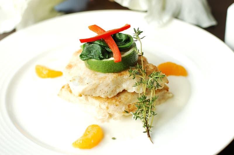Fish steak with vegetables. Barramundi fish steak stock images