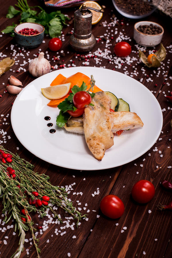 Fish steak with vegetables stock photo