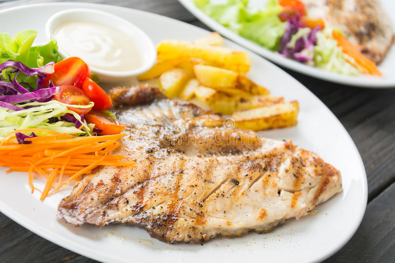 Fish steak. On wood table royalty free stock images