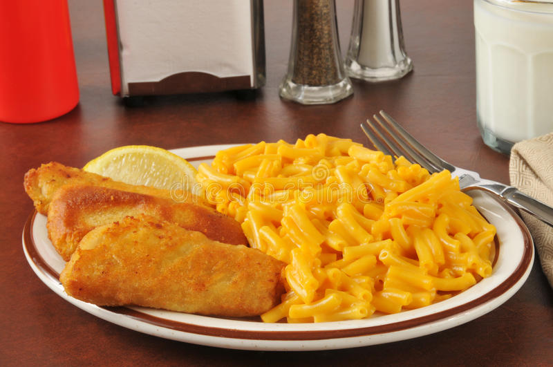Fish sticks with macaroni and cheese stock photos