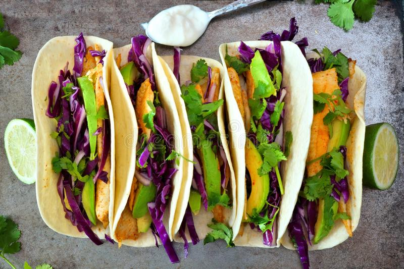 Fish tacos with red cabbage lime slaw on rustic tray royalty free stock photos