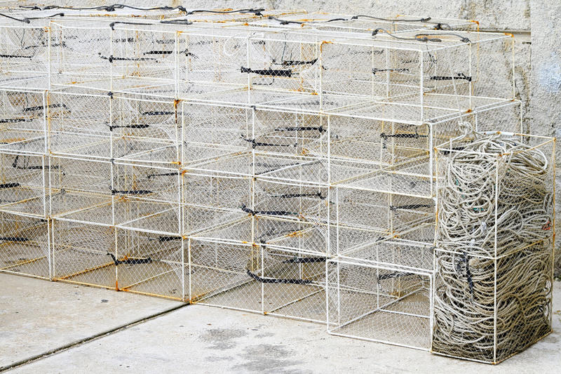 Fish trap cages. Bunch of deep fishing traps and cages stock photo