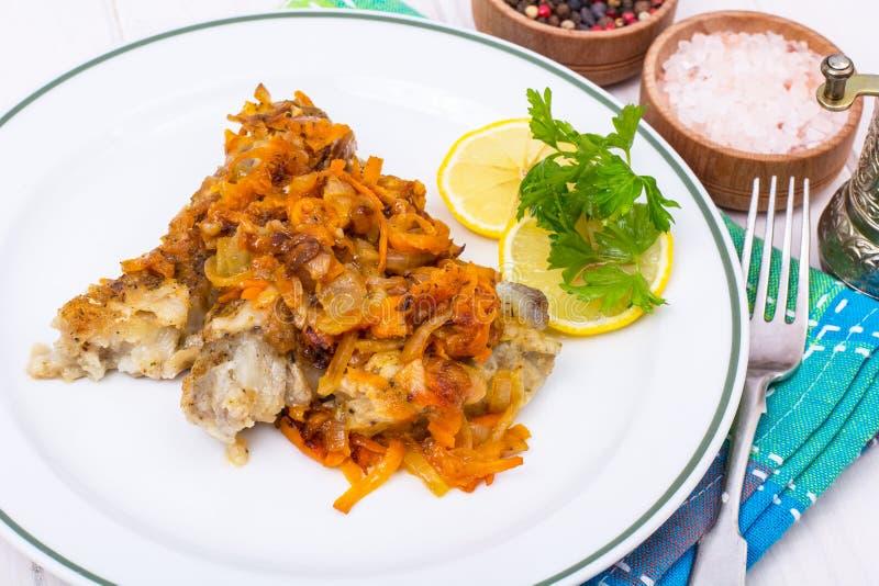 Fish with vegetable marinade. Studio Photo royalty free stock photo