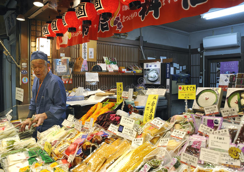 Fish vendor at food market stall in Nishiki market in Kyoto. stock image