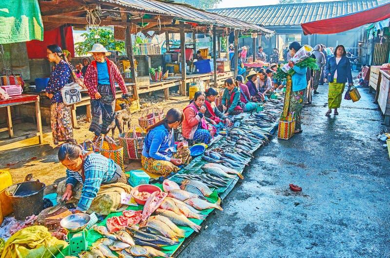 Fish vendors, Mingalar Market, Nyaungshwe, Myanmar royalty free stock images