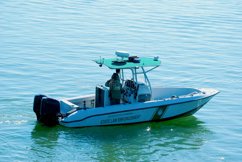 Fish and Wildlife Commission boat on patrol. Fish and Wildlife Commission State Law Enforcement boat on patrol stock image
