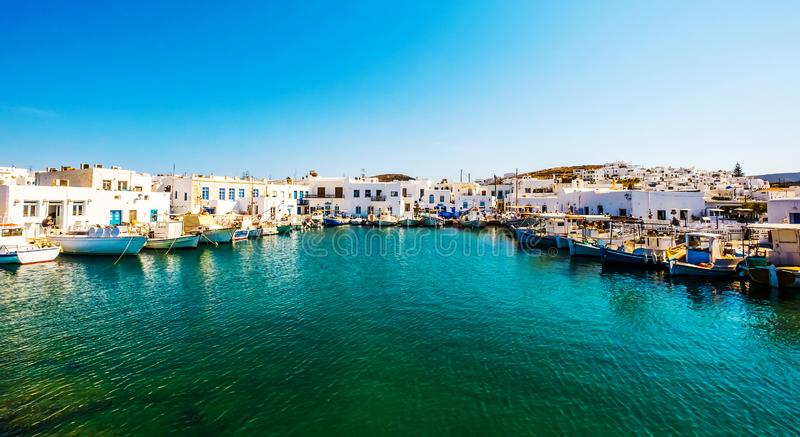 Fishboats and yachts moored in Naoussa port, Greece stock photography