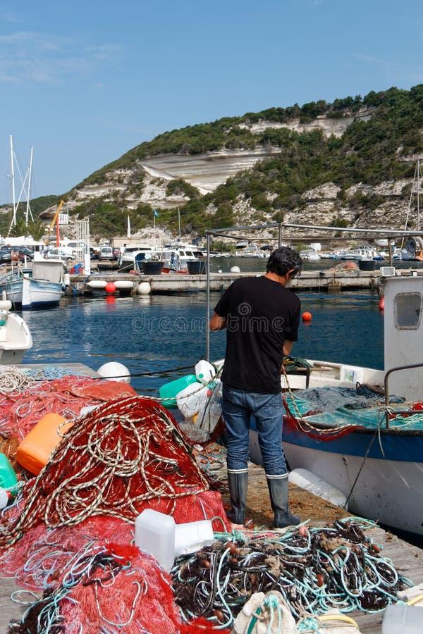 Fishemrnan sorting his nets royalty free stock photos