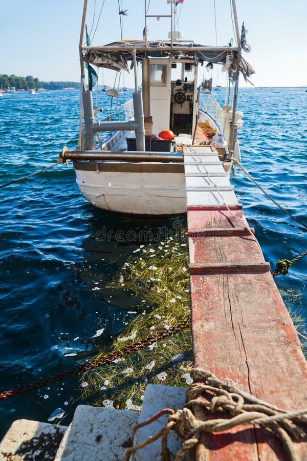 Fisher łódź w Porec, Chorwacja zdjęcia royalty free