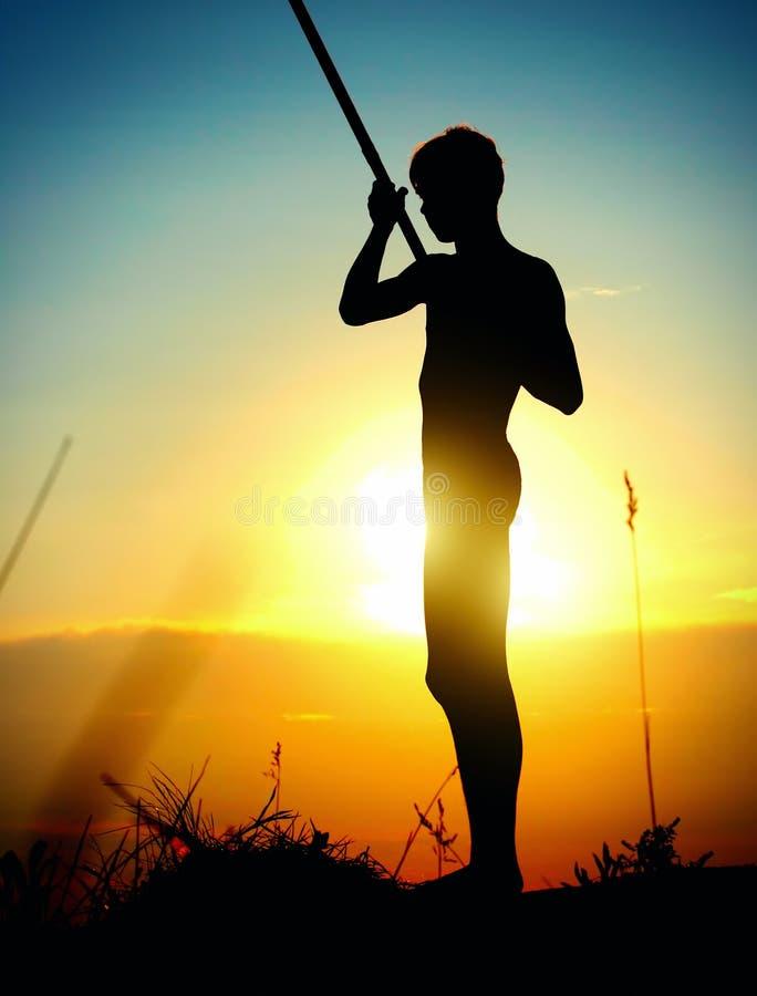 Fisher на заходе солнца стоковое изображение rf