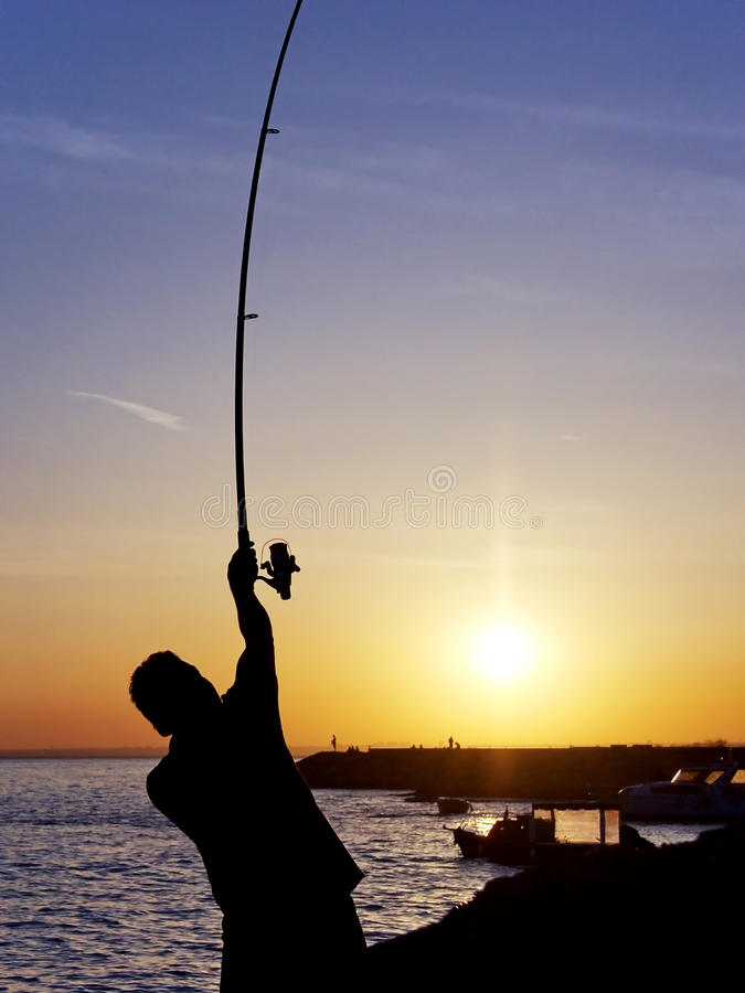 Fisher against sun royalty free stock image