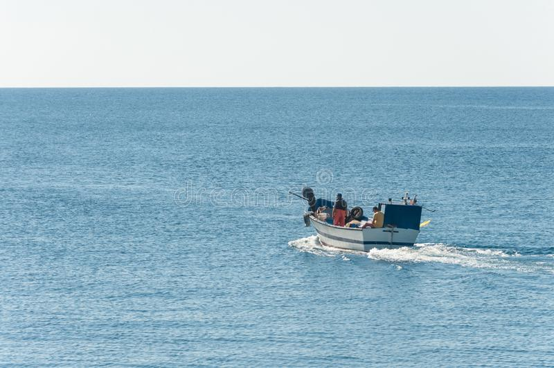 Fisher boat in action at sea royalty free stock image