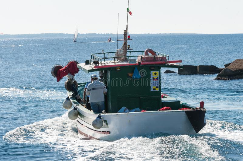 Fisher boat in action at sea royalty free stock photography