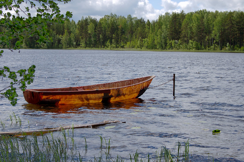 Fisher boat on a lake royalty free stock image