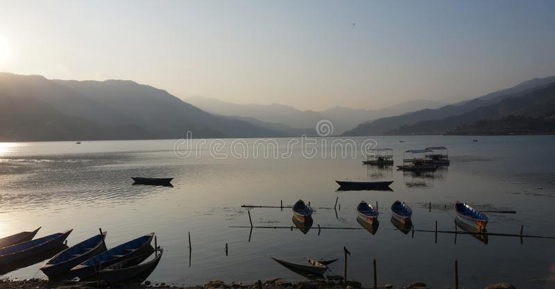 Fisher boats lake Pokhara in Nepal royalty free stock images